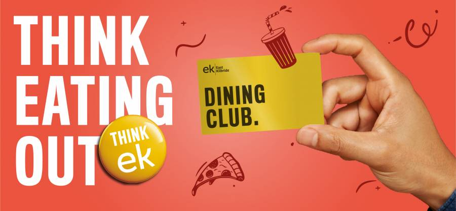 hand holding dining club card