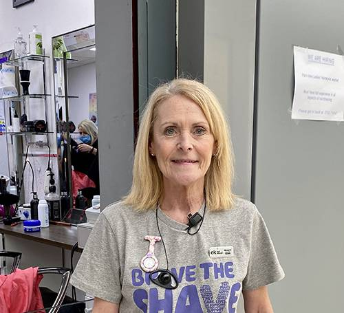 Person wearing Brave The Shave t shirt